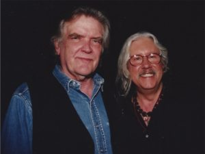Guy with Arlo Guthrie-1